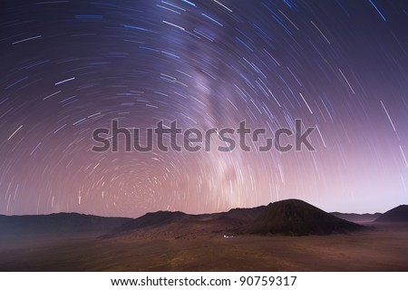 Shot with a long exposure of a rotating stellar sky over Bromo volcano, Indonesia