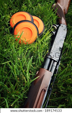Shotgun and Clay Pigeons