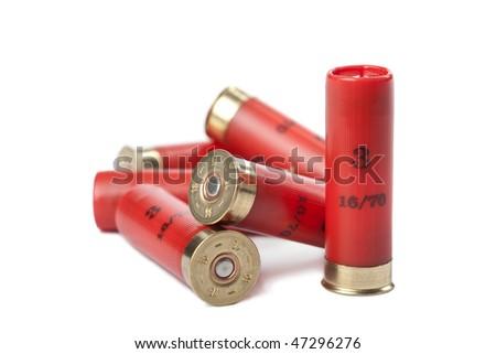 shotgun cartridges isolated over white - stock photo