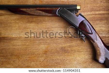 Shotgun on wood