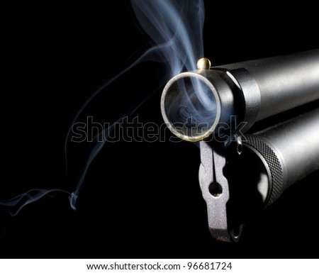 Shotgun that is blowing smoke after is has been used to shoot