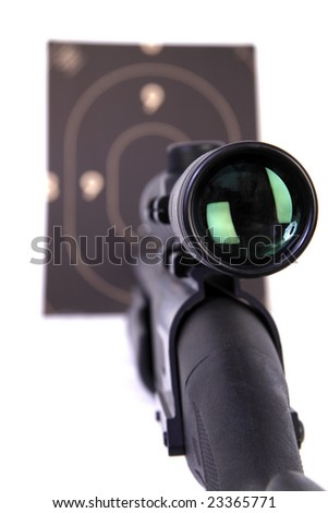Shotgun with a rifle scope pointing a target . 12 Caliber . selective focus