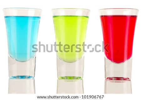 Shots - Three colourful shot drinks on a white background with reflections