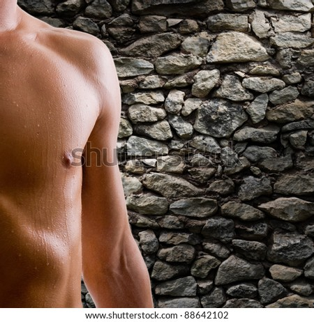 shoulder and arm naked male body (an athlete)