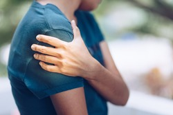 Shoulder Injuries , young woman with pain in shoulder, Ache in human body , office syndrome , health care concept