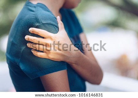 Shoulder Injuries , young woman with pain in shoulder, Ache in human body , office syndrome , health care concept ストックフォト ©