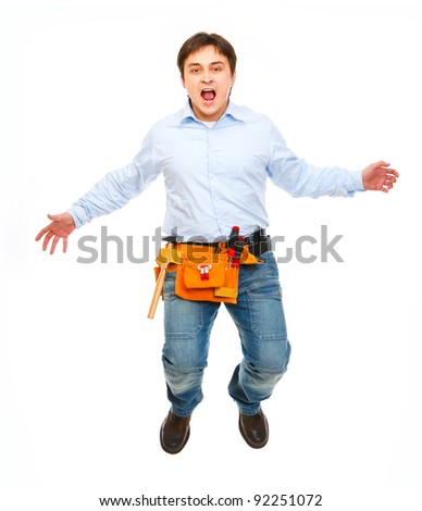 Shouting construction worker jumping