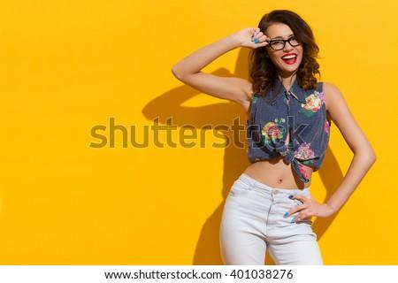 shouting girl in glasses posing ...