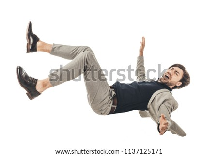 shouting young businessman in suit falling isolated on white