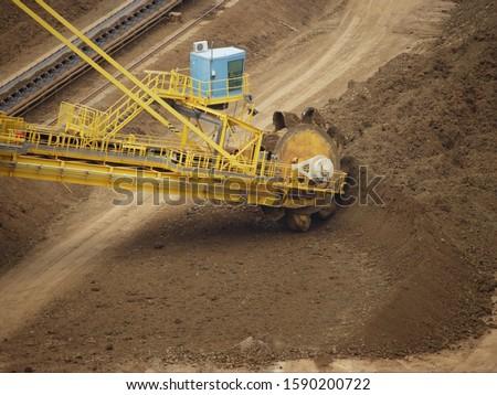 Shovel Excavator digging nickelous soil near Koumac, New Caledonia, Overseas Territory of France