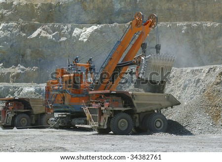 shovel loading truck with tons of copper ore
