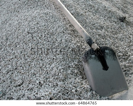 Shovel on a heap of gravel