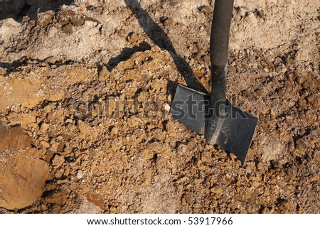 Shovel putted into heap of ground