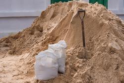 Shovel sand for construction.,A shovel in a sand