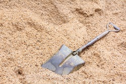 Shovel (spade) and sand for construction