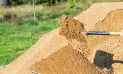 Shovel with earth, pour sand, close-up