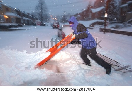 Shoveling snow from a sidewalk