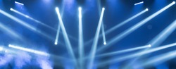 Show must go on. Empty stage with blue spotlights. Blue stage lights. Concert live streams available online. Background for online concert. Live streaming concert. Online event. Stage for musicians