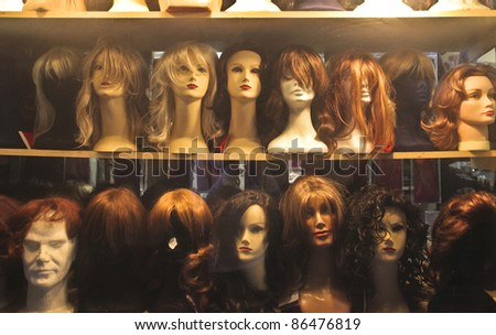 Show window with wigs exposed