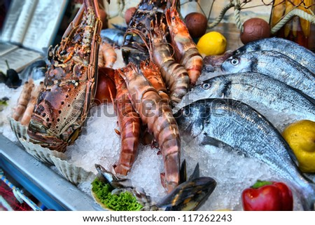 showcase of seafood in the sea market