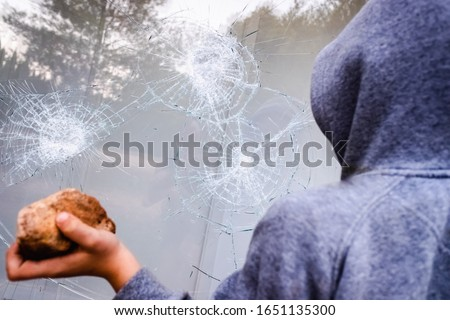 Showcase with broken glass during a protest in a city with protesters. Foto stock ©
