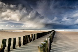 shower clouds over North sea beach, Netherlands