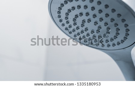 Shower head in douche on white background