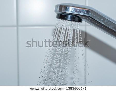shower head with splashing water in douche