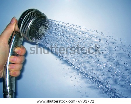 shower in hand on blue background