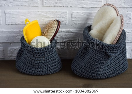 Shower set. Toiletries. Gray knitted bag with shower accessories. Wisp, soap, sponge and comb. Bodycare kit. #1034882869