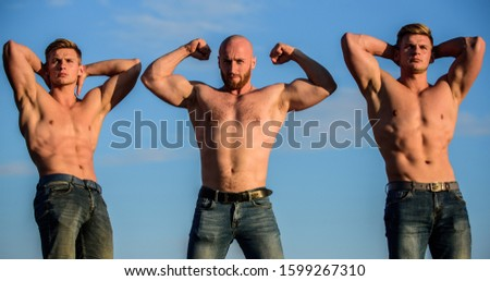 showing abs and biceps. full of energy. Inspiring better health. three muscular men sky. athletic bodybuilders. sport concept. Sexy men with muscular body. Brutal macho. Strong men are sexy.