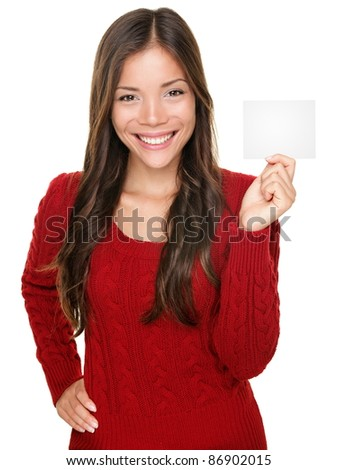 showing woman presenting blank gift card sign. Happy smiling Asian woman in red winter sweater isolated on white background.