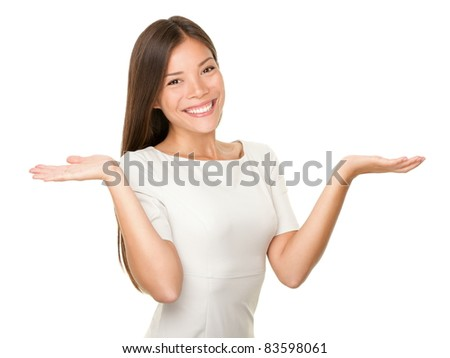 Showing woman - two hands empty for product or text. Casual woman isolated on white background. Multi-racial Caucasian / Asian female model smiling happy.