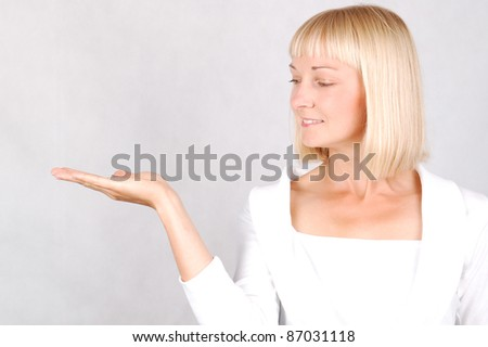 Showing Young Woman/Young Woman gesturing by showing hand - stock photo