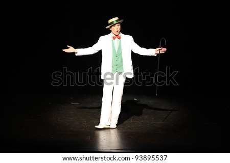 Showman,actor entertainer presenting show or product in the theatre or theater