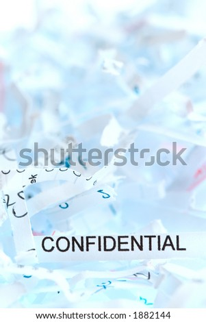 "Shredded paper. Focus on the word ""confidential""."