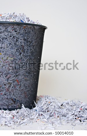 Shredded Paper in and around the basket with blank space on the right side