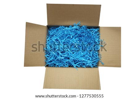 Shredded Paper Packing Material. Blue Spaghetti shredded packing paper used to protect fragile object while in transport. Backgrounds and Texture.