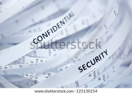 "Shredded paper series - confidential  and security. Selective focus on word ""security"""