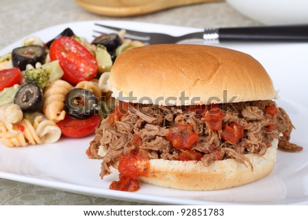 Shredded roast beef sandwich with pasta salad