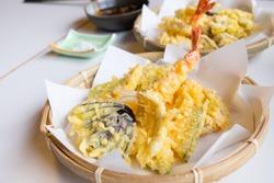 shrimp and vegetable tempura on a bamboo basket