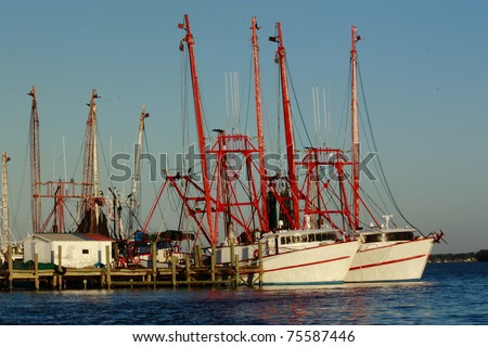 Shrimp Boats for Sale http://www.shutterstock.com/pic-75587446/stock-photo-shrimp-boat-docked-on-the-st-johns-river-jacksonville-florida.html
