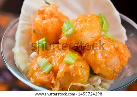 Shrimp dynamite in glass cup, sauce, leeks Stockfoto ©