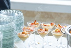 Shrimp   grits side dish appetizer in fancy martini cocktail glasses - steaming hot southern comfort food cuisine