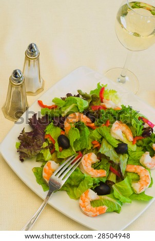Shrimp salad and glass of white wine