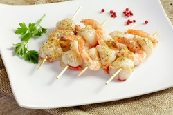 shrimp skewers and spicy scallops