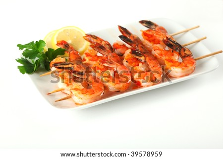 Shrimp skewers with sweet garlic chili sauce on white background