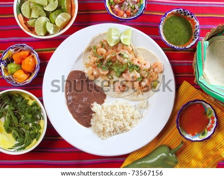 shrimp tacos rice and frijoles chili sauces Mexican seafood