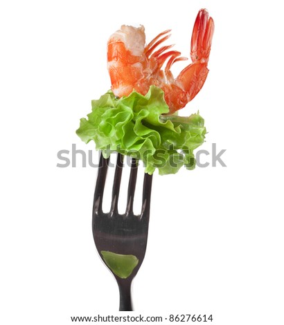shrimp with fresh salad lettuce on fork isolated on white