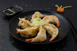 Shrimps Dumplings Steamed recipe chinese Food Style. Served soy sauce is popular new year delicious Asian dish sideview